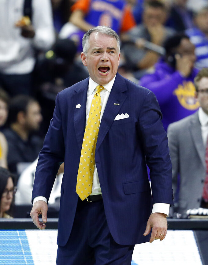 Wofford head coach Mike Young shouts to players during the first half of a second-round game against Kentucky in the NCAA men's college basketball tournament in Jacksonville, Fla., Saturday, March 23, 2019. (AP Photo/Stephen B. Morton)