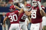 Arkansas punter Reid Bauer (30), place kicker Cam Little (29)and defensive lineman John Ridgeway (99) celebrate a field goal kicked by Little in the first half of an NCAA college football game against Texas A&M in Arlington, Texas, Saturday, Sept. 25, 2021. (AP Photo/Tony Gutierrez)