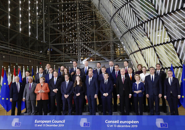 European Union leaders pose for a group photo during an EU summit in Brussels, Thursday, Dec. 12, 2019. European Union leaders gathered for their year-end summit and discussed climate change funding, the departure of the UK from the bloc and their next 7-year budget. (AP Photo/Olivier Matthys)