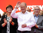 FILE - In this Friday, Sept. 24, 2021 file photo, Olaf Scholz, German Finance Minister and Social Democratic Party, SPD, candidate for Chancellor, waves during the final election campaign event in Cologne, Germany. Germany's closely fought election on Sunday will set the direction of the European Union's most populous country after 16 years under Angela Merkel, whose party is scrambling to avoid defeat by its center-left rivals after a rollercoaster campaign. (AP Photo/Martin Meissner, POOL, File)