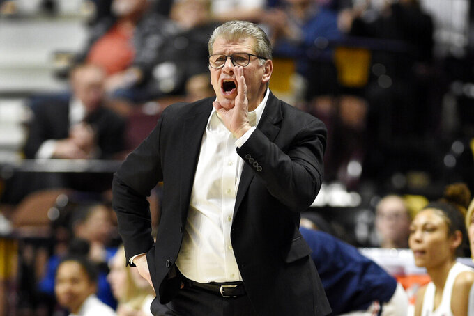 FILE - This March 7, 2020, file photo shows Connecticut head coach Geno Auriemma during an NCAA college basketball game in the American Athletic Conference tournament quarterfinals at Mohegan Sun Arena, in Uncasville, Conn. UConn has not had seven first-year players on its roster since back in 1988, the year the Huskies won the first of their 18 Big East titles.  No. 3 Connecticut returns this season to the league it helped build with a young, but talented team after playing seven years in the American Athletic Conference without a conference loss.(AP Photo/Jessica Hill, File)