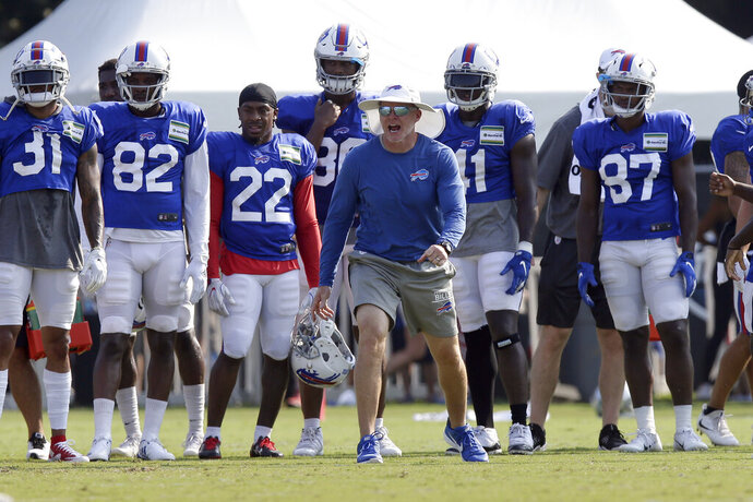 FILE - In this Aug 13, 2019, file photo, Buffalo Bills coach Sean McDermott yells during the team's NFL football training camp with the Carolina Panthers in Spartanburg, S.C. NFL general managers and coaches, and those who assist them, work within a highly competitive culture. Putting in extremely long hours is simply understood as part of the job. Unless, there's a pandemic. (AP Photo/Gerry Broome, File)