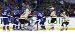 Boston Bruins left wing Brad Marchand, far right, celebrates after scoring against the Tampa Bay Lightning during the second period of an NHL hockey game Monday, March 25, 2019, in Tampa, Fla. (AP Photo/Chris O'Meara)