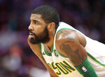 Boston Celtics guard Kyrie Irving looks on during the first half of an NBA basketball game against the Miami Heat, Thursday, Jan. 10, 2019, in Miami. (AP Photo/Joel Auerbach)