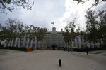 A dog walks outside the Supreme Court in Madrid, Spain, Monday, Oct. 14, 2019. Spain's Supreme Court is set to rule on a rebellion and sedition trial against a dozen Catalan politicians and activists who were key protagonists in Catalonia's Oct. 1, 2017, independence referendum. (AP Photo/Paul White)