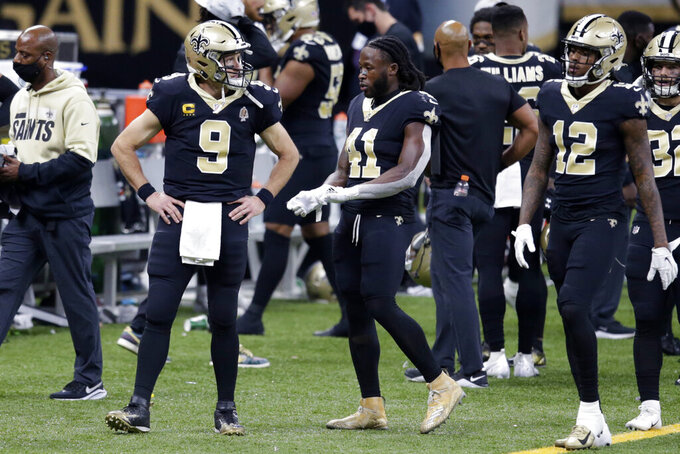 New Orleans Saints quarterback Drew Brees (9) walks on the sideline with running back Alvin Kamara (41) in the second half of an NFL football game against the San Francisco 49ers in New Orleans, Sunday, Nov. 15, 2020. Brees was replaced by quarterback Jameis Winston. (AP Photo/Butch Dill)