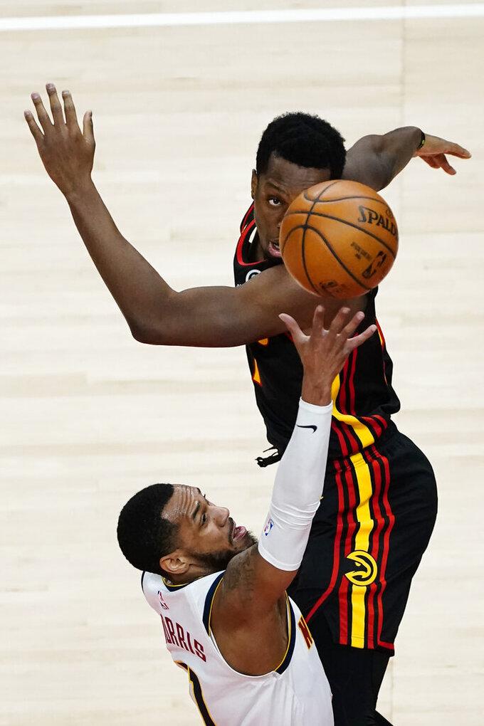 Denver Nuggets guard Monte Morris (11) goes up for a basket as Atlanta Hawks forward Onyeka Okongwu (17) during the first half of an NBA basketball game Sunday, Feb. 21, 2021, in Atlanta. (AP Photo/John Bazemore)
