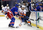 New York Rangers' Jacob Trouba (8) rides New York Islanders' Casey Cizikas in to the boards during the third period of an NHL hockey game Thursday, Jan. 14, 2021, in New York. (Bruce Bennett/Pool Photo via AP)