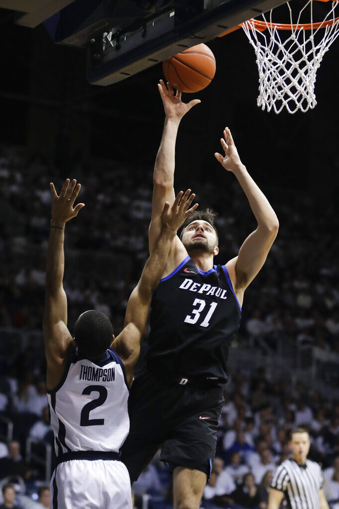 DePaul's Max Strus (31) shoots next to  Butler's Aaron Thompson (2) during the second half of an NCAA college basketball game Saturday, Feb. 16, 2019, in Indianapolis. Butler won 91-78. (AP Photo/Darron Cummings)