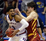 Kansas forward Dedric Lawson (1) drives on Iowa State forward Michael Jacobson (12) during the second half of an NCAA college basketball game in Lawrence, Kan., Monday, Jan. 21, 2019. Kansas defeated Iowa State 80-76. (AP Photo/Orlin Wagner)