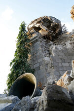 A bell is seen below after a 6.1 magnitude earthquake toppled the belfry of St. Catherine church in Porac township, Pampanga province north of Manila, Philippines, Tuesday, April 23, 2019. The strong earthquake struck the northern Philippines Monday trapping some people in a collapsed building, damaged an airport terminal and knocked out power in at least one province, officials said. (AP Photo/Bullit Marquez)