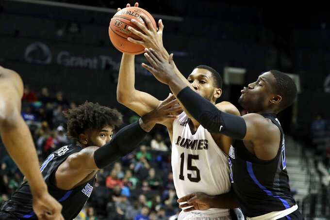 St. Bonaventure forward LaDarien Griffin (15) drives to the basket against Saint Louis forward Hasahn French, left, and guard Fred Thatch Jr. during the first half of an NCAA college basketball final game in the Atlantic 10 men's tournament, Sunday, March 17, 2019, in New York. (AP Photo/Julio Cortez)
