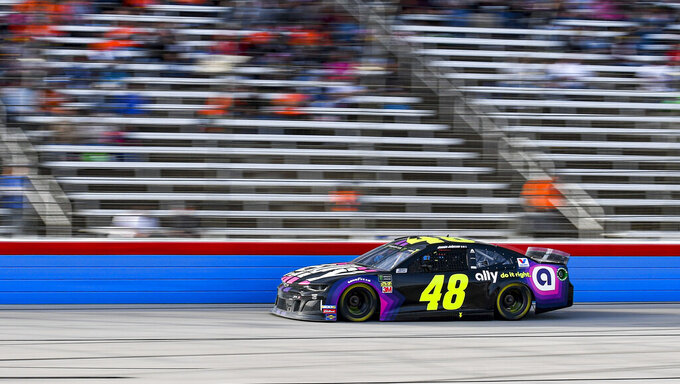 "FILE - In this Nov. 3, 2019, file photo, Jimmie Johnson (48) races down the front stretch during a NASCAR Cup Series auto race at Texas Motor Speedway in Fort Worth, Texas. As he prepares for his final season of full-time racing, the most accomplished driver of his generation has changed his mindset. ""I'm not chasing anything,"" said Johnson, who is determined to enjoy his 19th and final Cup season. (AP Photo/Randy Holt, File)"