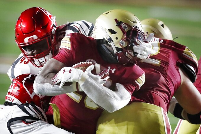 Louisville defensive lineman Jared Dawson (93) commits a face mask penalty on Boston College running back Travis Levy (23) during the second half of an NCAA college football game, Saturday, Nov. 28, 2020, in Boston. (AP Photo/Michael Dwyer)