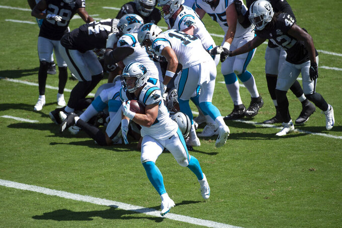 Carolina Panthers running back Christian McCaffrey scores against the Las Vegas Raiders during the first half of an NFL football game Sunday, Sept. 13, 2020, in Charlotte, N.C. (AP Photo/Mike McCarn)