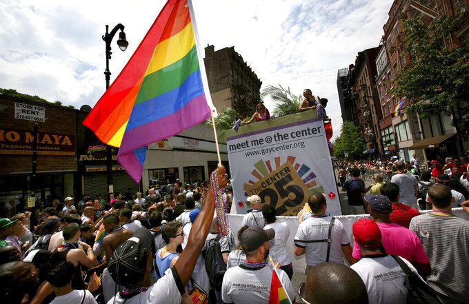 FILE - In this June 29, 2008 file photo, a crowd surges along Eighth Street as marchers pack the street during the gay pride parade in New York. Organizers of New York City's Pride events said Saturday, May 15, 2021 they are banning police and other law enforcement from marching in their huge annual parade until at least 2025 and will also seek to keep on-duty officers a block away from the celebration of LGBTQ people and history. (AP Photo/Craig Ruttle, File)