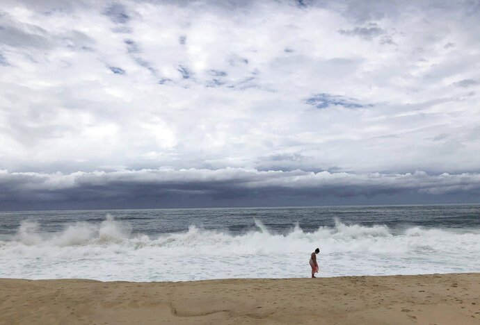 Waves crash on the beach in San Jose del Cabo, Mexico, Wednesday, June 13, 2018, before the arrival of Tropical Storm Bud. A tropical storm warning was issued for a stretch of coastline from Santa Fe to La Paz that includes the twin resort cities of Los Cabos. (AP Photo/Juliet Williams)