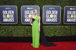Charlize Theron arrives at the 77th annual Golden Globe Awards at the Beverly Hilton Hotel on Sunday, Jan. 5, 2020, in Beverly Hills, Calif. (Photo by Jordan Strauss/Invision/AP)