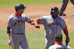 San Francisco Giants' Austin Slater, left, and Pablo Sandoval congratulate each other after they scored on a single by Mike Yastrzemski during the sixth inning of a baseball game against the Los Angeles Dodgers Sunday, Aug. 9, 2020, in Los Angeles. (AP Photo/Mark J. Terrill)