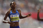 Dalilah Muhammad of the United States wins the gold medal in the women's 400 meter hurdles final at the World Athletics Championships in Doha, Qatar, Friday, Oct. 4, 2019. (AP Photo/Petr David Josek)
