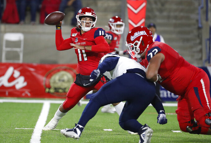 Fresno State quarterback Jorge Reyna drops back to pass during the first half of the team's NCAA college football game against Nevada in Fresno, Calif., Saturday, Nov. 23, 2019. (AP Photo/Gary Kazanjian)