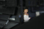 A bank employee watches computer monitors at a foreign exchange dealing room in Seoul, South Korea, Friday, Sept. 24, 2021. Asian shares were mixed Friday amid concerns over troubled Chinese real estate developer Evergrande and over the pandemic.(AP Photo/Lee Jin-man)