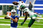 New York Jets cornerback Pierre Desir (35) breaks a a pass to Indianapolis Colts wide receiver Michael Pittman (11) in the first half of an NFL football game in Indianapolis, Sunday, Sept. 27, 2020. (AP Photo/Darron Cummings)