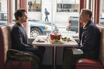 This image released by Sony Pictures shows Tom Hanks as Mister Rogers, right, and Matthew Rhys in a scene from