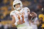 Texas quarterback Sam Ehlinger (11) runs for a touchdown during the second half of an NCAA college football game against West Virginia, Saturday, Oct. 5, 2019, in Morgantown, W.Va. (AP Photo/Raymond Thompson)