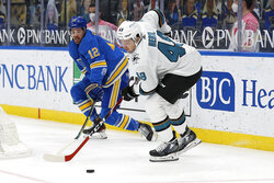 San Jose Sharks' Tomas Hertl (48), of the Czech Republic, handles the puck in front of St. Louis Blues' Zach Sanford (12) during the first period of an NHL hockey game Saturday Feb. 20, 2021, in St. Louis. (AP Photo/Scott Kane)