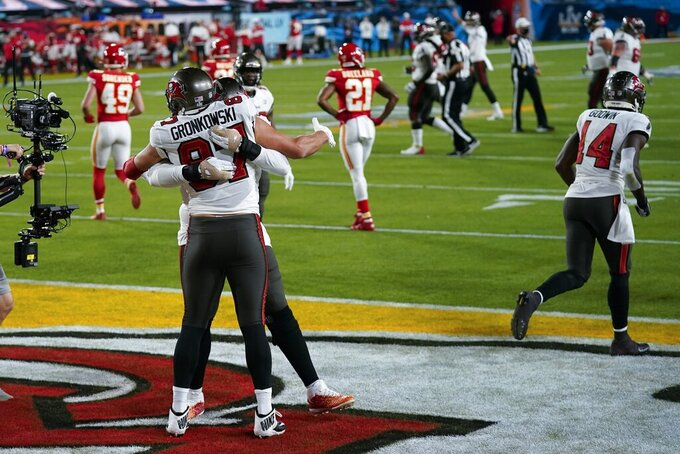 Tampa Bay Buccaneers tight end Rob Gronkowski celebrates after scoring against the Kansas City Chiefs during the first half of the NFL Super Bowl 55 football game, Sunday, Feb. 7, 2021, in Tampa, Fla. (AP Photo/David J. Phillip)