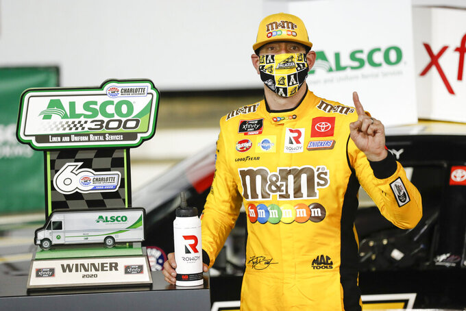Kyle Busch celebrates after winning the NASCAR Xfinity Series auto race at Charlotte Motor Speedway Monday, May 25, 2020, in Concord, N.C. (AP Photo/Gerry Broome)