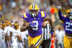 LSU's Andre Anthony runs back a fumble for a touchdown against Central Michigan during an NCAA college football game Saturday, Sept. 18, 2021, in Baton Rouge, La. (Scott Clause/The Daily Advertiser via AP)