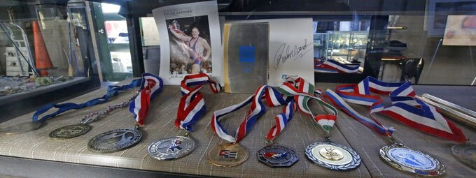 FILE - In this Oct. 25, 2014, file photo, Rulon Gardner's medals are shown at an auctioneer's warehouse in Salt Lake City, Utah. An Olympic Channel documentary debuting Wednesday, July 22, 2020, chronicles the highs and lows of Rulon Gardner in the 20 years since his stunning gold-medal victory in the 2000 Olympics. (AP Photo/Rick Bowmer, File)