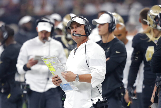 New Orleans Saints head coach Sean Payton watches from the sideline in the first half of an NFL football game against the Houston Texans in New Orleans, Monday, Sept. 9, 2019. (AP Photo/Bill Feig)