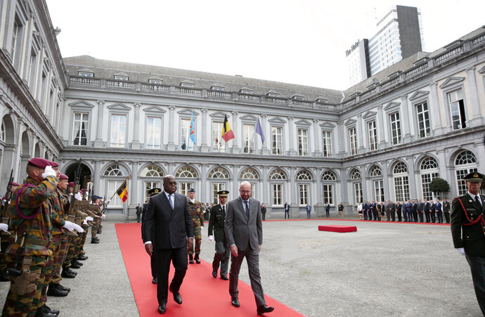 Belgian Prime Minister Charles Michel, center right, and Democratic Republic of Congo President Felix Tshisekedi, center left, review the troops during an arrival ceremony at the Egmont Palace in Brussels, Tuesday, Sept. 17, 2019. (AP Photo/Virginia Mayo)