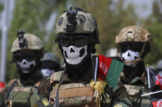 FILE - In this July 17, 2021 file photo, new Afghan Army Special Forces attend their graduation ceremony after a three-month training program at the Kabul Military Training Center, in Kabul, Afghanistan. In an interview with The Associated Press Thursday, July 22, 2021, Suhail Shaheen, Afghan Taliban spokesman and a member of the Taliban negotiation team, said the insurgent movement does not want to monopolize power, but there won't be peace until there is a new, negotiated government in Kabul and Afghan President Ashraf Ghani is removed. Shaheen said women will be allowed to work, go to school, and participate in politics but will have to wear the hijab, or headscarf. (AP Photo/Rahmat Gul)