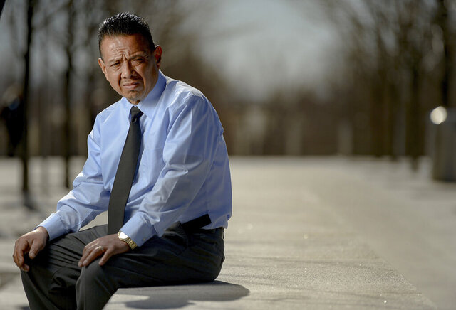 In this Friday, Feb. 14, 2020, photo, Jose Lopez, who was attacked at his Utah tire store, sits outside the federal courthouse in Salt Lake City, where he has testified against the man who yelled,