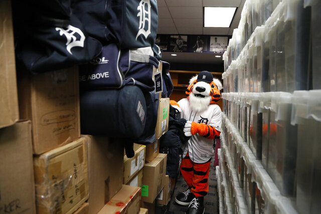 Paws, the Detroit Tigers mascot, helps load equipment at Comerica Park in Detroit, Monday, Feb. 3, 2020 in preparation for the move to Lakeland, Fla., for the opening of spring training. (AP Photo/Carlos Osorio)