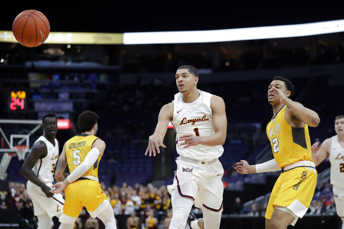 Loyola of Chicago's Lucas Williamson (1) passes the ball as Valparaiso's Deion Lavender (2) watches during the first half of an NCAA college basketball game in the quarterfinal round of the Missouri Valley Conference tournament, Friday, March 8, 2019, in St. Louis. (AP Photo/Jeff Roberson)