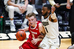 Wisconsin forward Tyler Wahl (5) drives on Purdue forward Aaron Wheeler (1) during the first half of an NCAA college basketball game in West Lafayette, Ind., Tuesday, March 2, 2021. (AP Photo/Michael Conroy)