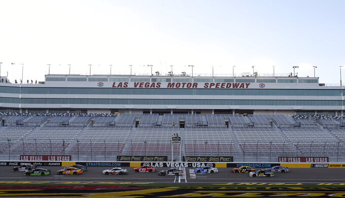 Drivers compete in a NASCAR Cup Series auto race without fans, Sunday, Sept. 27, 2020, in Las Vegas. (AP Photo/Isaac Brekken)