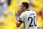 Germany's Robin Gosens celebrates after scoring his side's fourth goal during the Euro 2020 soccer championship group F match between Portugal and Germany at the Football Arena stadium in Munich, Germany, Saturday, June 19, 2021. (Philipp Guelland/Pool via AP)