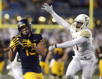 West Virginia wide receiver David Sills V (13) makes a catch while being defend by Baylor cornerback Jameson Houston (11) during the first half of an NCAA college football game, Thursday, Oct. 25, 2018, in Morgantown, W.Va. (AP Photo/Raymond Thompson)