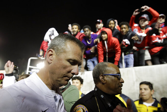 Ohio State coach Urban Meyer leaves the field after Ohio State defeated Washington 28-23 in the Rose Bowl NCAA college football game Tuesday, Jan. 1, 2019, in Pasadena, Calif. (AP Photo/Jae C. Hong)