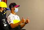 Renault driver Daniel Ricciardo of Australia gestures as he attends the press conference in the build-up to the 70th Anniversary Formula One Grand Prix at the Silverstone circuit, Silverstone, England, Thursday, Aug. 6, 2020.(Mark Sutton/Pool via AP)