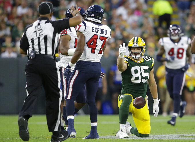 "Green Bay Packers tight end Robert Tonyan signals ""first down"" after completing a catch during the first half of the team's NFL preseason football game against the Houston Texans on Thursday, Aug. 8, 2019, in Green Bay, Wis. (AP Photo/Jeffrey Phelps)"