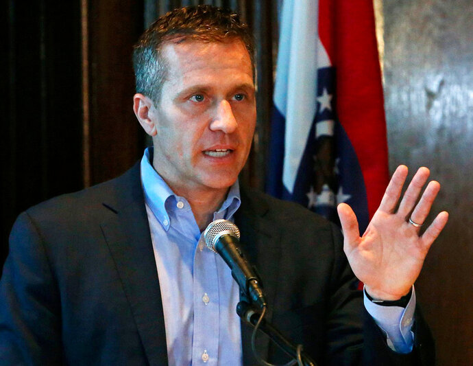 FILE - In this April 11, 2018 file photo, Missouri Gov. Eric Greitens speaks at a news conference in Jefferson City, Mo., about allegations related to an extramarital affair with his hairdresser. Missouri Attorney General Josh Hawley said Tuesday, April 17, 2018, he believes there's enough evidence to bring a criminal charge and pursue impeachment of Gov. Eric Greitens for allegedly using a charity donor list for political purposes.  (J.B. Forbes/St. Louis Post-Dispatch via AP, File)