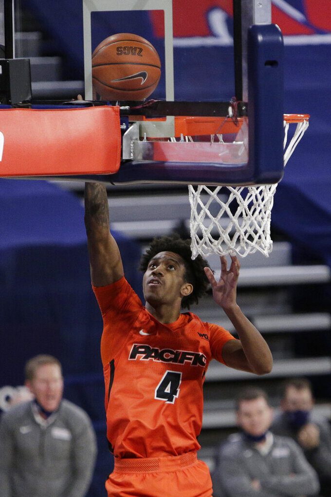 Pacific guard Daniss Jenkins shoots during the first half of the team's NCAA college basketball game against Gonzaga in Spokane, Wash., Saturday, Jan. 23, 2021. (AP Photo/Young Kwak)