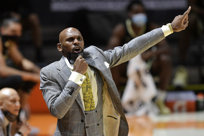 Vanderbilt head coach Jerry Stackhouse directs his players during an NCAA college basketball game against Tennessee at Thompson-Boling Arena in Knoxville, Tenn., Saturday, Jan. 16, 2021. (Calvin Mattheis/Knoxville News Sentinel via AP, Pool)